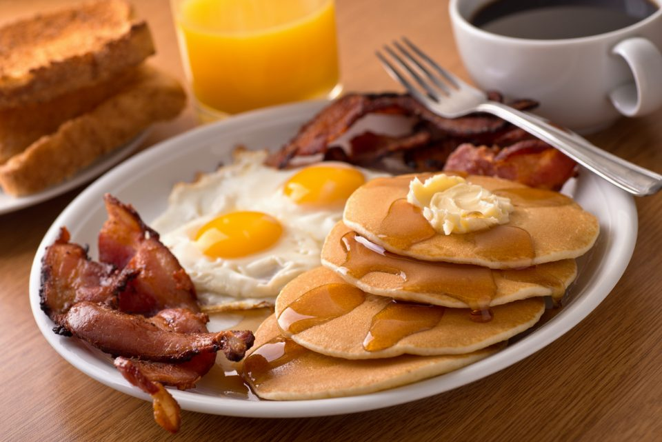 Charity breakfast with bacon, eggs, pancakes, and toast